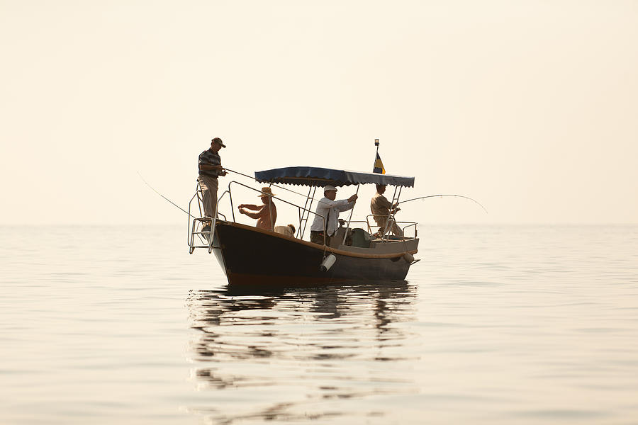 Angler Photograph - Men Go Fishing From A Boat by Serhii Odarchenko