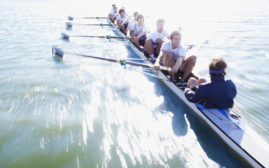 Men in row boat oaring Photograph by Clerkenwell
