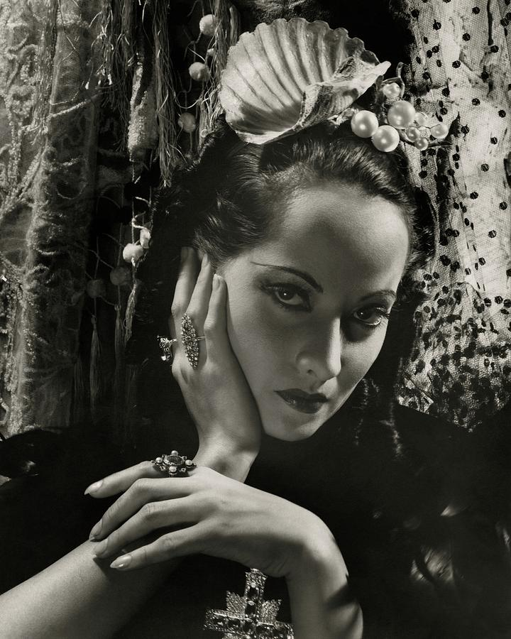 Merle Oberon Wearing A Headdress Photograph by Cecil Beaton