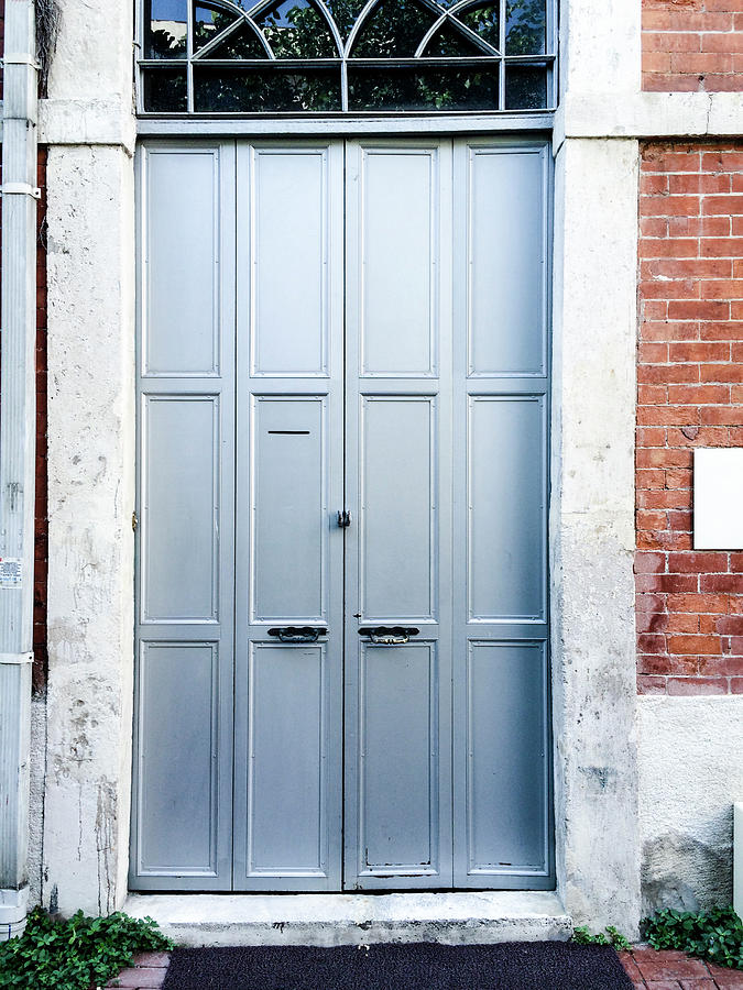 Metal Door With Stone Wall Photograph by Ediebloom