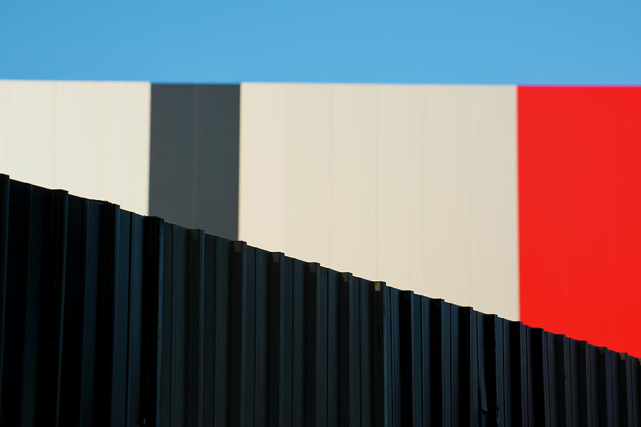 Metallic Fence Against Modern Colorful Photograph by Paolo Carnassale