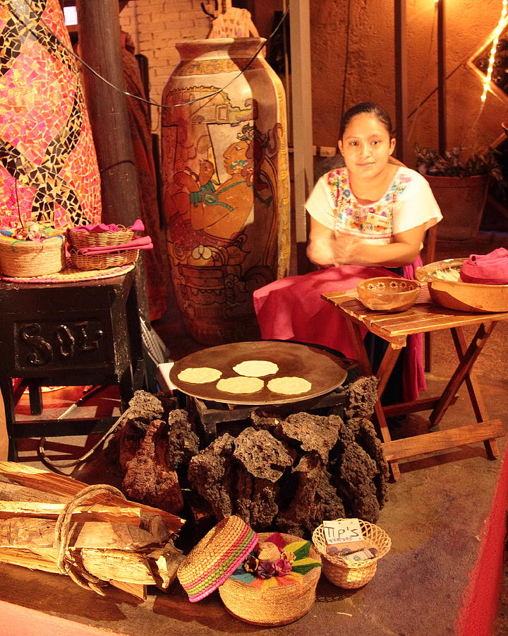 Mexican Photograph - Mexican Girl Making Tortillas by Roupen  Baker