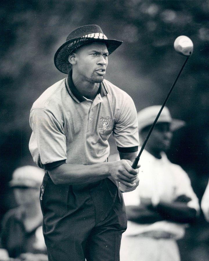 Classic Photograph - Michael Jordan Looks At Golf Shot by Retro Images Archive
