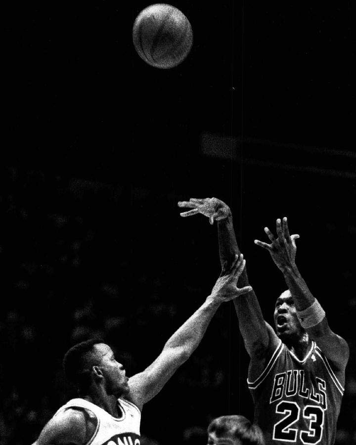 Classic Photograph - Michael Jordan Shooting Over Another Player by Retro Images Archive