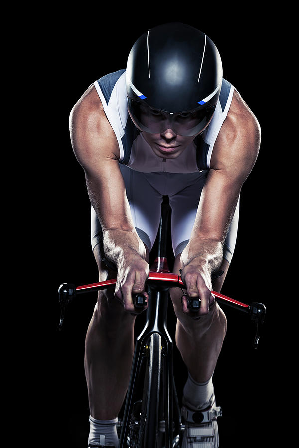 Mid Adult Woman Cycling, Studio Shot Photograph by Johner Images
