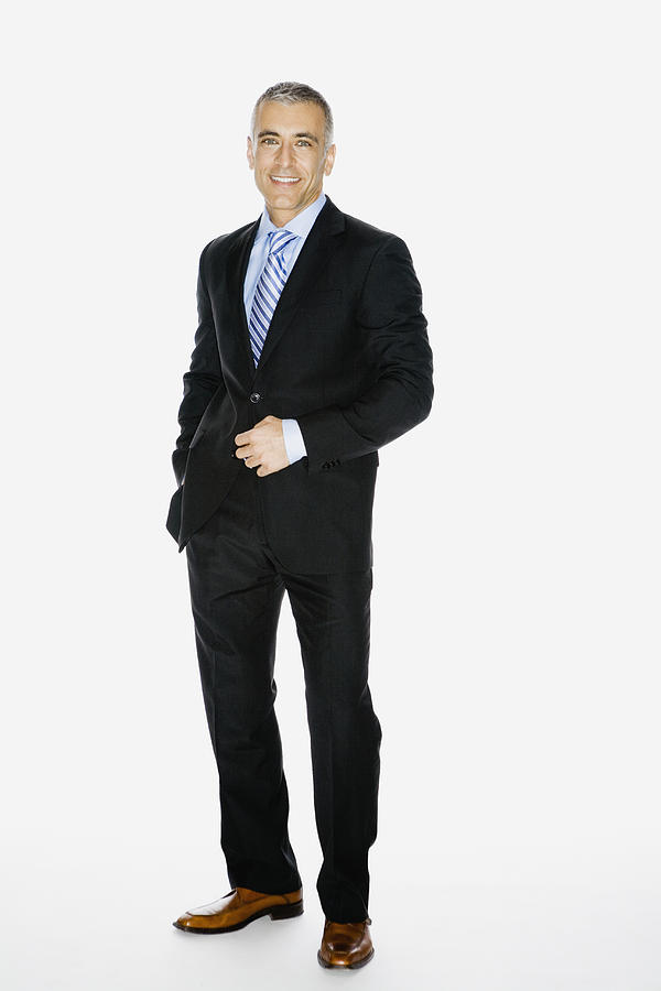 Middle Eastern businessman with hand on jacket button Photograph by Andersen Ross Photography Inc