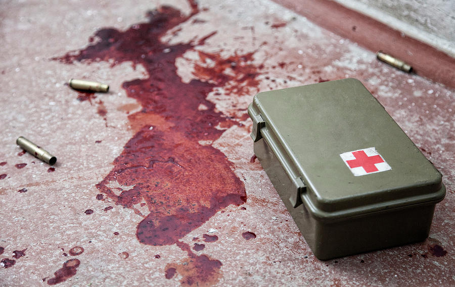 Military First Aid Kit On Floor