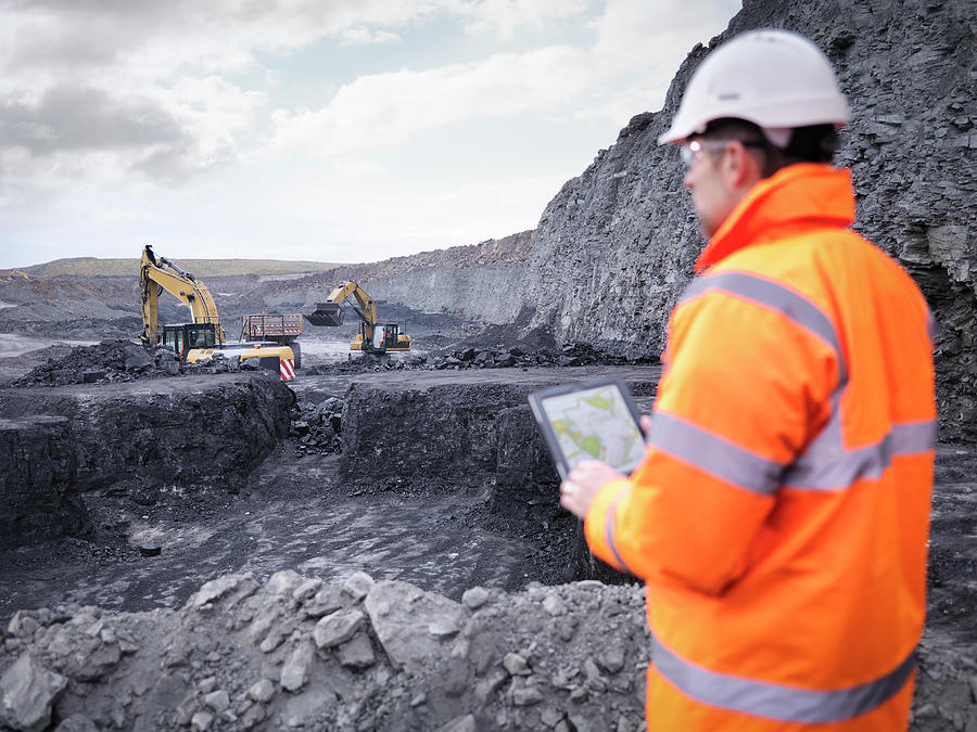 Miner Checks Plans On Digital Tablet In Photograph by Monty Rakusen