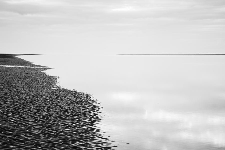 Black and white photograph minimalist long exposure black and white beach landscape by matthew gibson