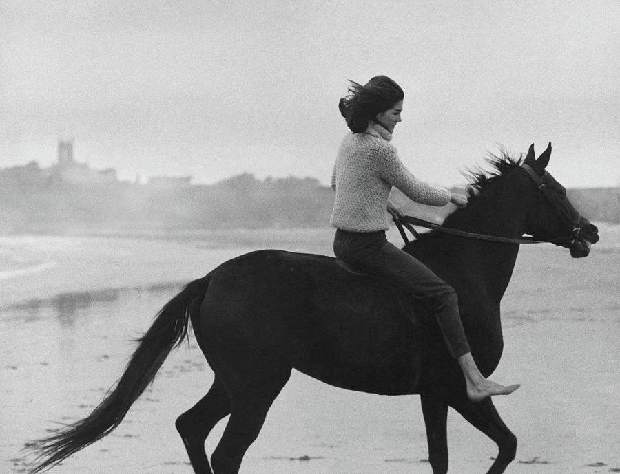 Minnie Cushing Riding A Horse Photograph by Toni Frissell