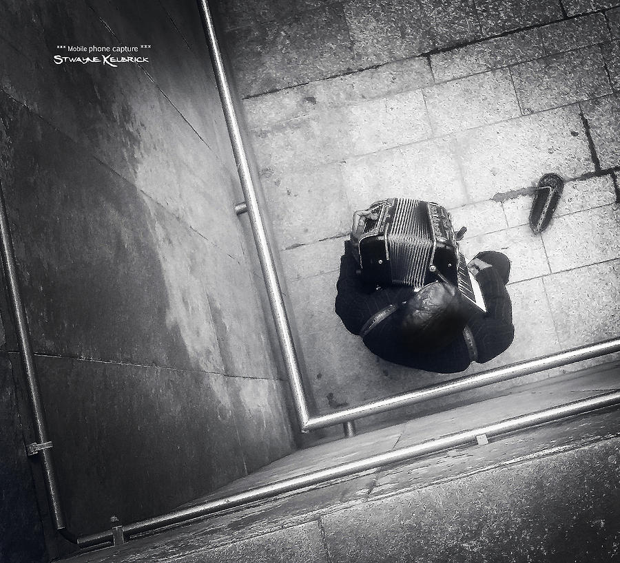 Black And White Photograph - Misery Of A Vagabond Musician by Stwayne Keubrick