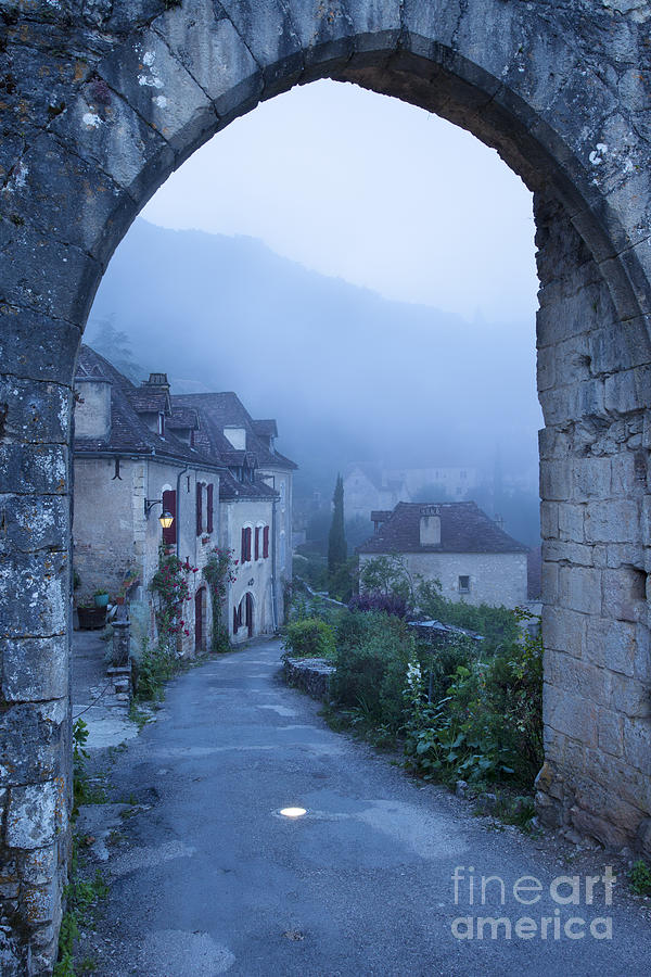 Arch Photograph - Misty Dawn In Saint Cirq Lapopie by Brian Jannsen