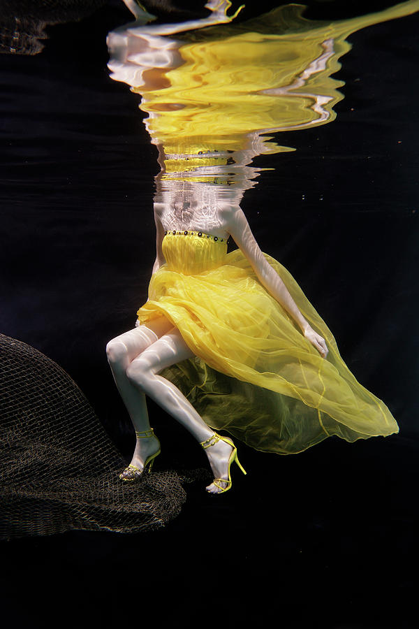 Mixed Race Woman In Dress Swimming Photograph by Ming H2 Wu