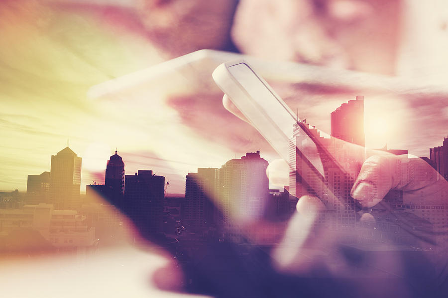 Mobile Phone In Hand With City Skyline. Photograph by Courtneyk
