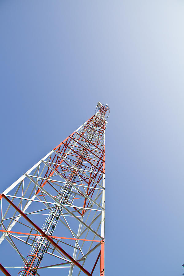 Antena Photograph - Mobile Tower Communication Antennas With Blue Sky Background by Jukree Boonprasit