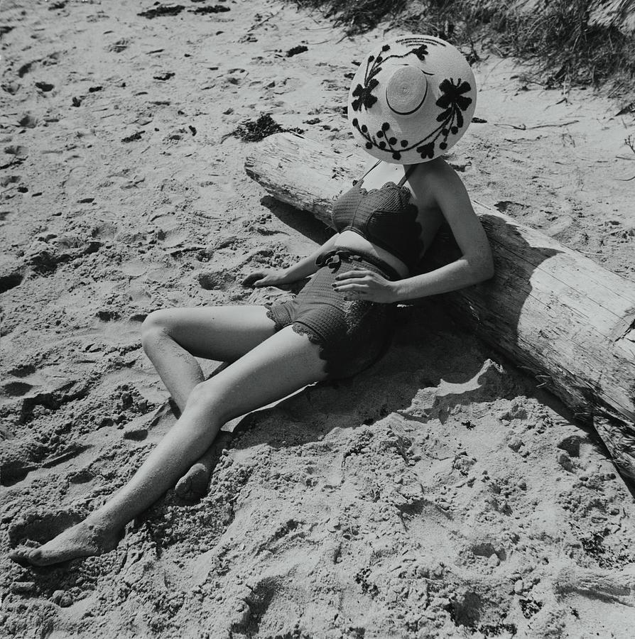 Model Covering Her Face With Hat On Beach Photograph by Toni Frissell