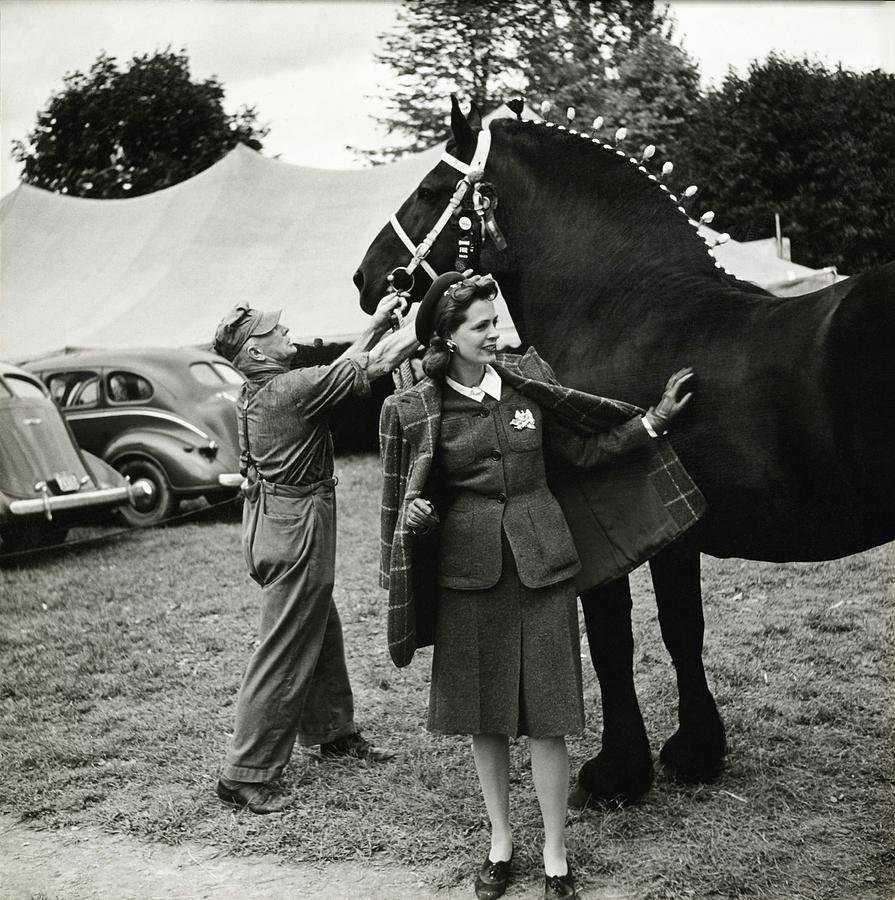 Model In Tweed Suit With Horse And Trainer Photograph by Toni Frissell