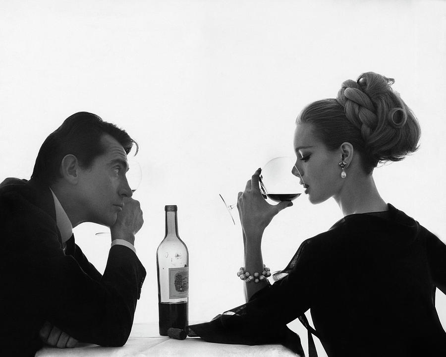 Man Gazing at Woman Sipping Wine Photograph by Bert Stern