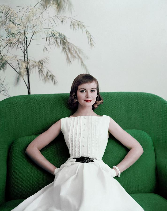 Model Phyllis Newell Sitting On A Green Sofa Photograph by Frances McLaughlin-Gill