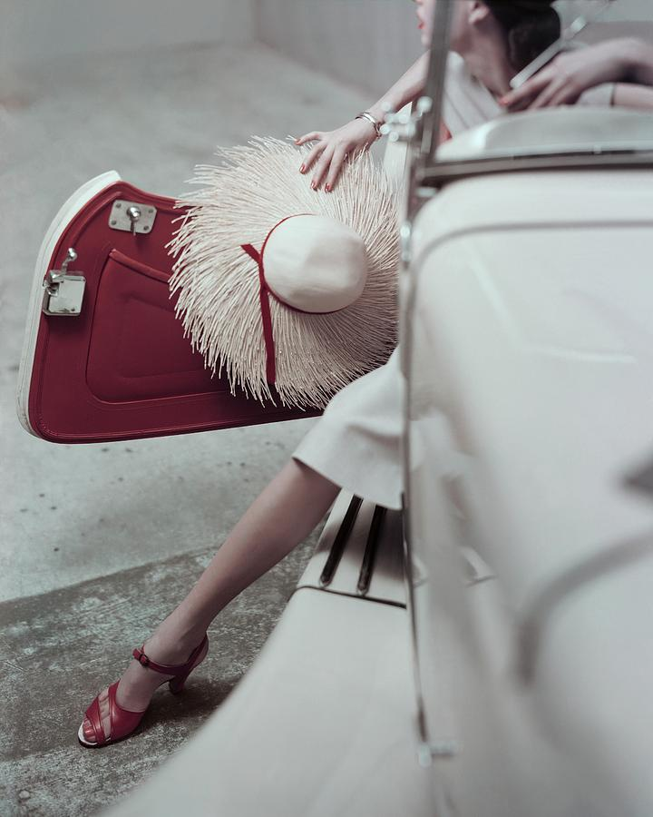 Model Stepping Out Of Car Photograph by Frances McLaughlin-Gill