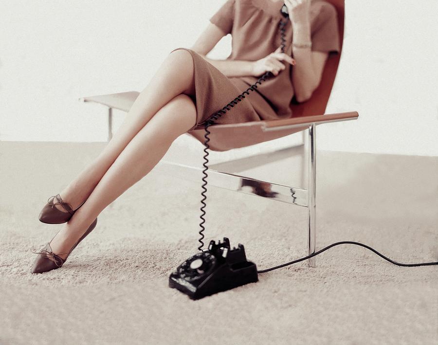 Model Talking On A Telephone Photograph by Karen Radkai