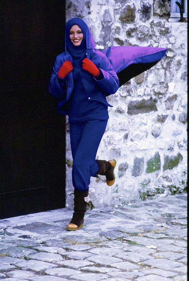 Model Wearing A Blue Raincoat Photograph by Arthur Elgort
