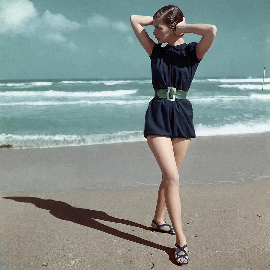 Model Wearing A Blue Swimsuit On A Beach Photograph by Serge Balkin