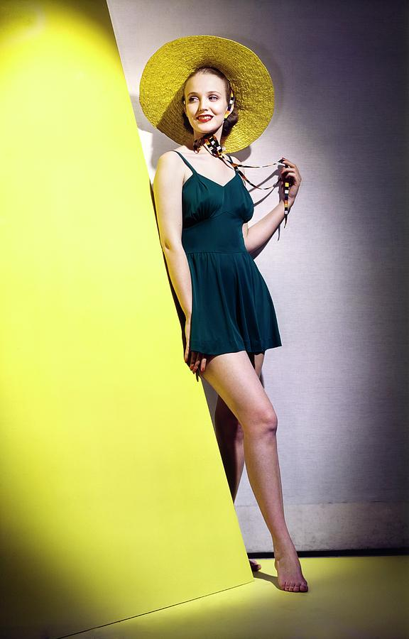 Model Wearing A Deauville Hat And A Bathing Suit Photograph by Horst P. Horst