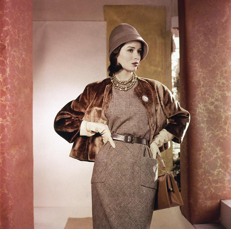 Model Wearing Fur Jacket With Dress And Hat Photograph by Horst P. Horst
