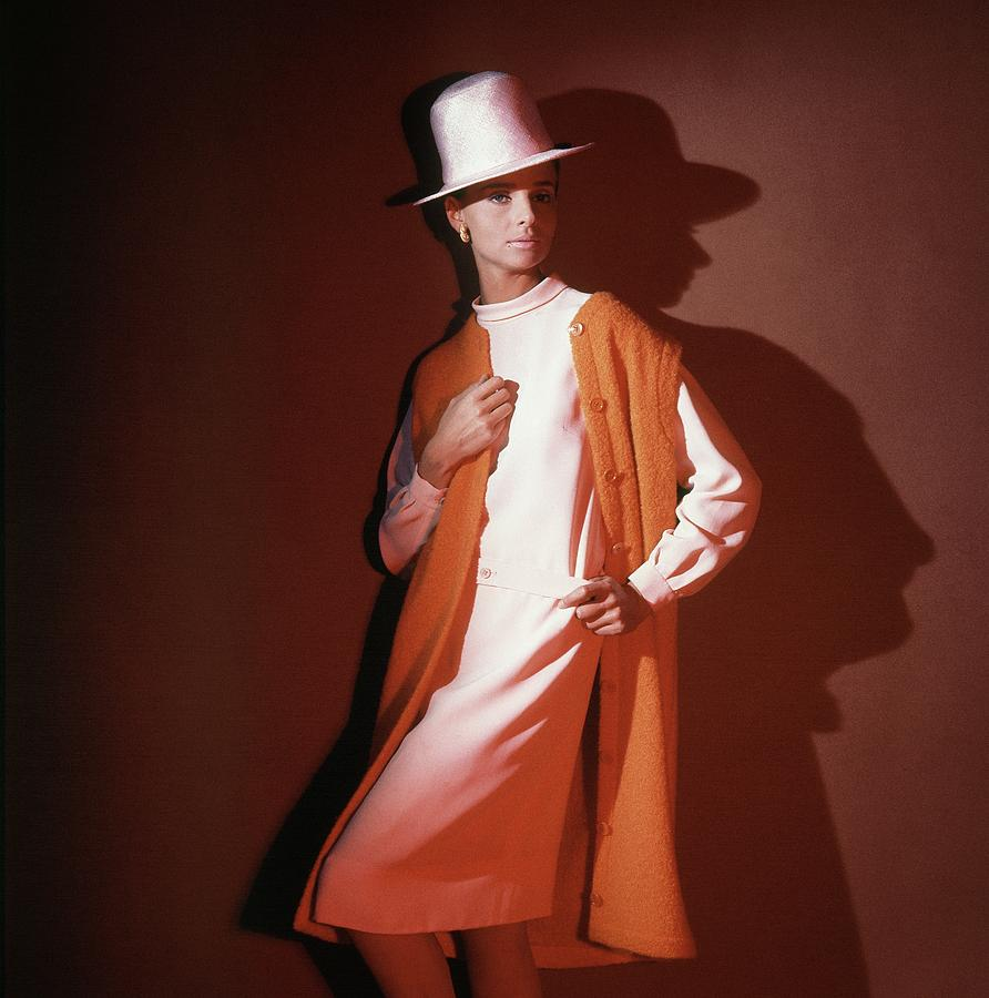 Model Wearing Orange Vest And White Hat Photograph by Horst P. Horst