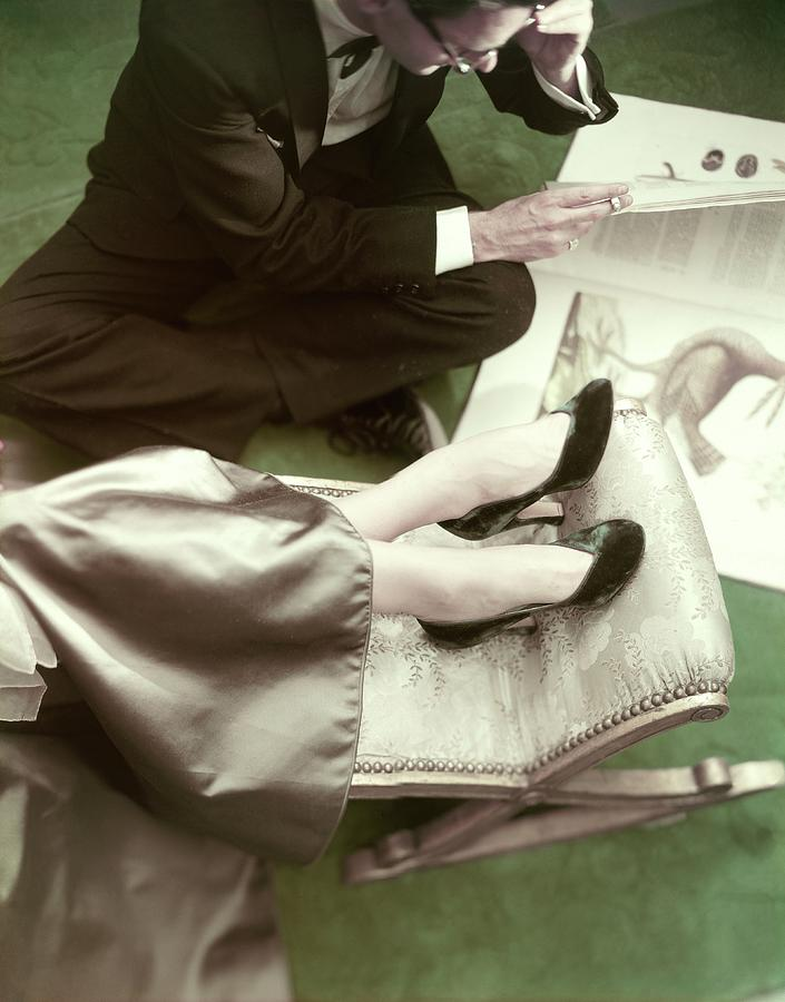 Model Wearing Velvet Pumps With A Man Sitting Photograph by Frances McLaughlin-Gill