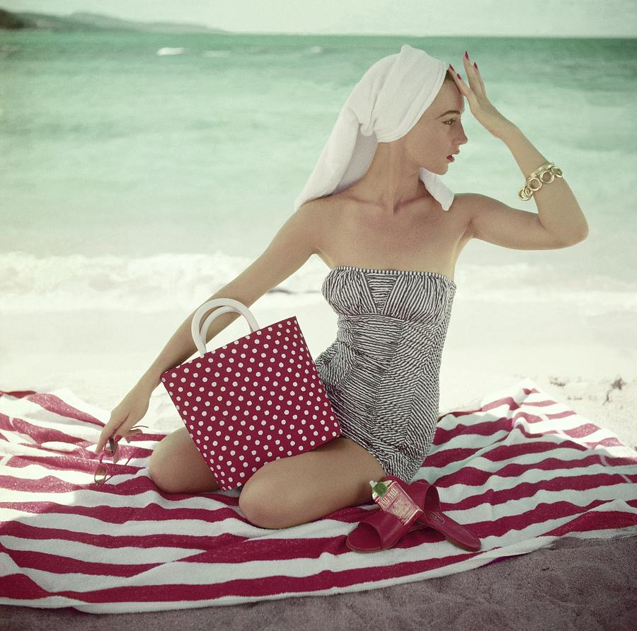 Model With A Polka Dot Bag On A Beach Photograph by Roger Prigent