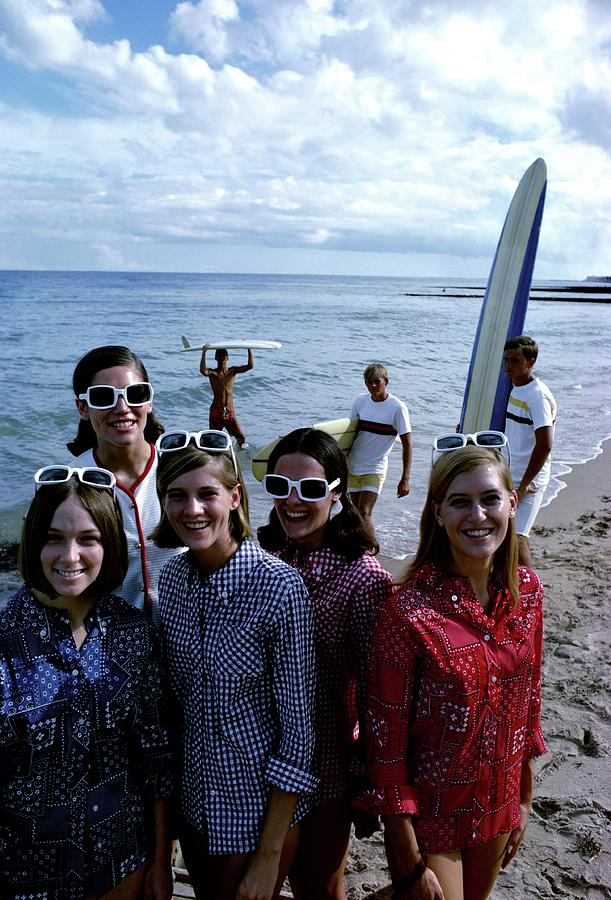 Models And Surfers On A Beach Photograph by William Connors