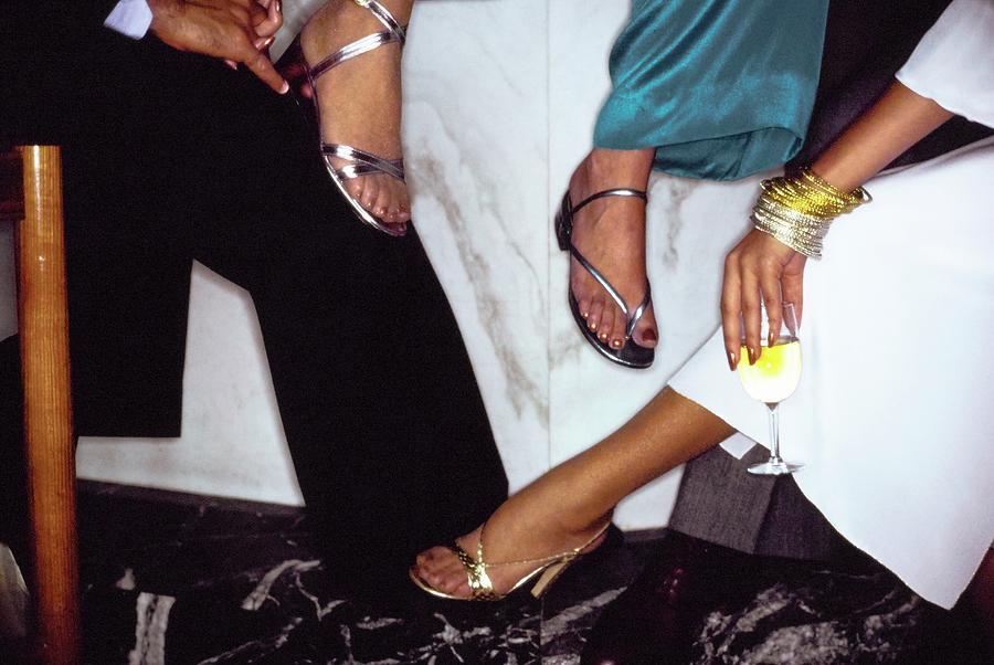 Models Feet Wearing Metallic Sandals Photograph by Arthur Elgort