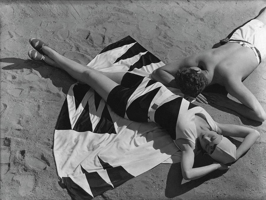 Models Lying On A Beach Photograph by George Hoyningen-Huene