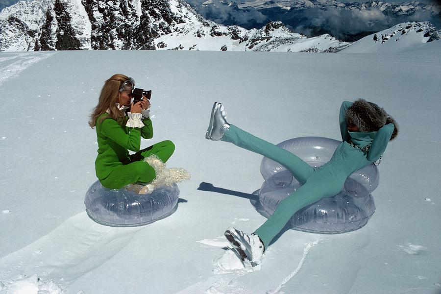 Models On Plastic Chairs With Snow In Switzerland Photograph by Arnaud de Rosnay