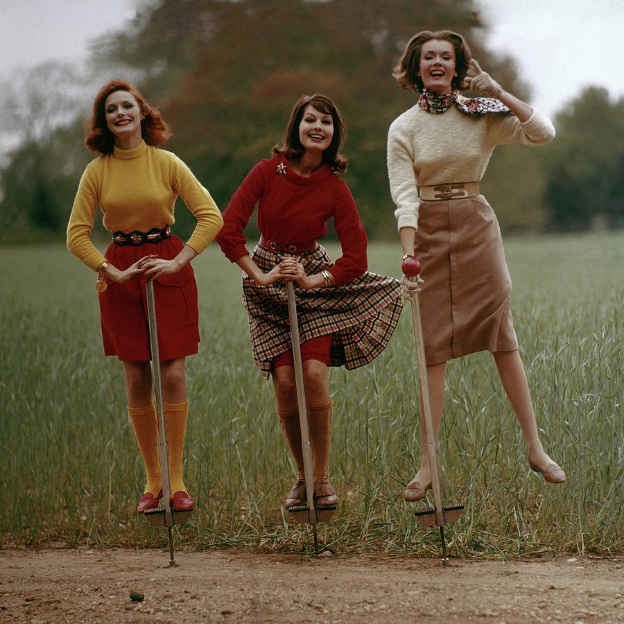 Models On Pogo Sticks Photograph by Frances McLaughlin-Gill