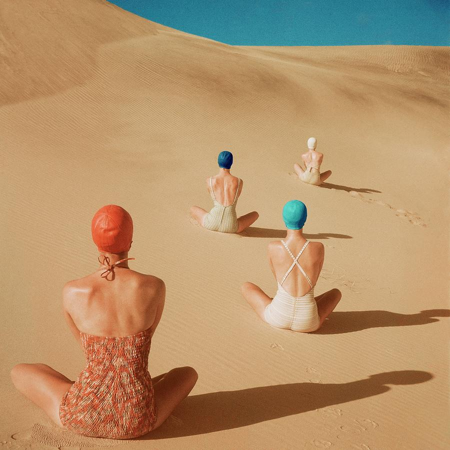 Models Sitting On Sand Dunes Photograph by Clifford Coffin