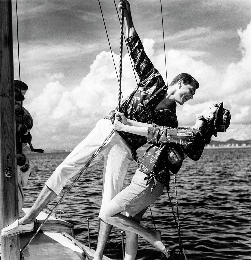 Models Wearing A Bennett Shirts On A Sailboat Photograph by Richard Waite