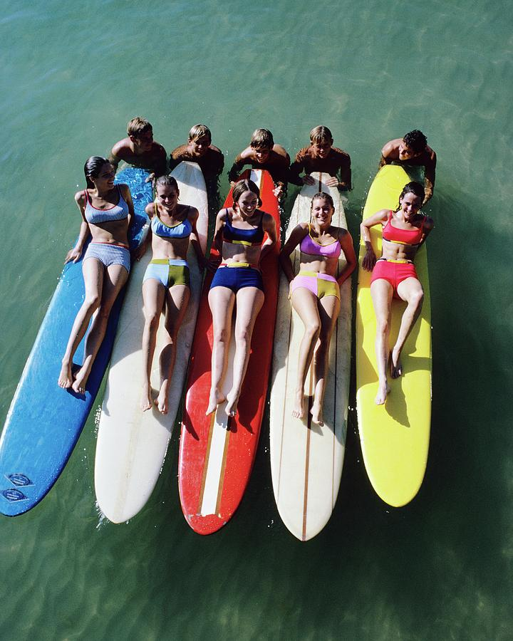 Models Wearing Bikinis Lying On Surfboards Photograph by William Connors