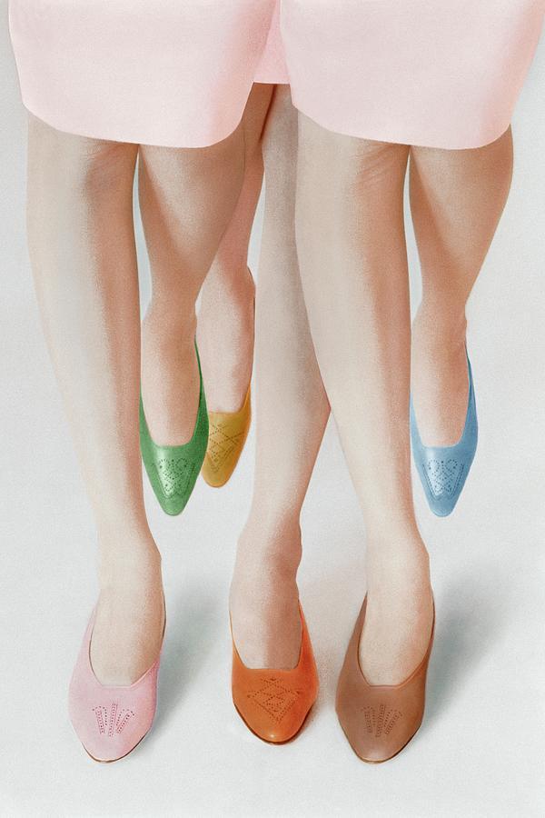 Models Wearing Colorful Pumps Photograph by Louis Faurer
