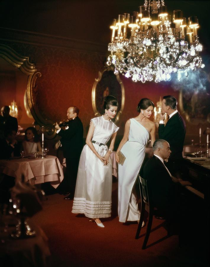 Models Wearing Evening Gowns In El Morocco Night Photograph by John Rawlings