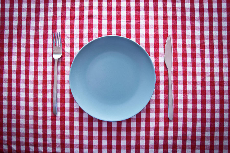 Modern Blue Plate On Red Checkered Photograph by Kkong5