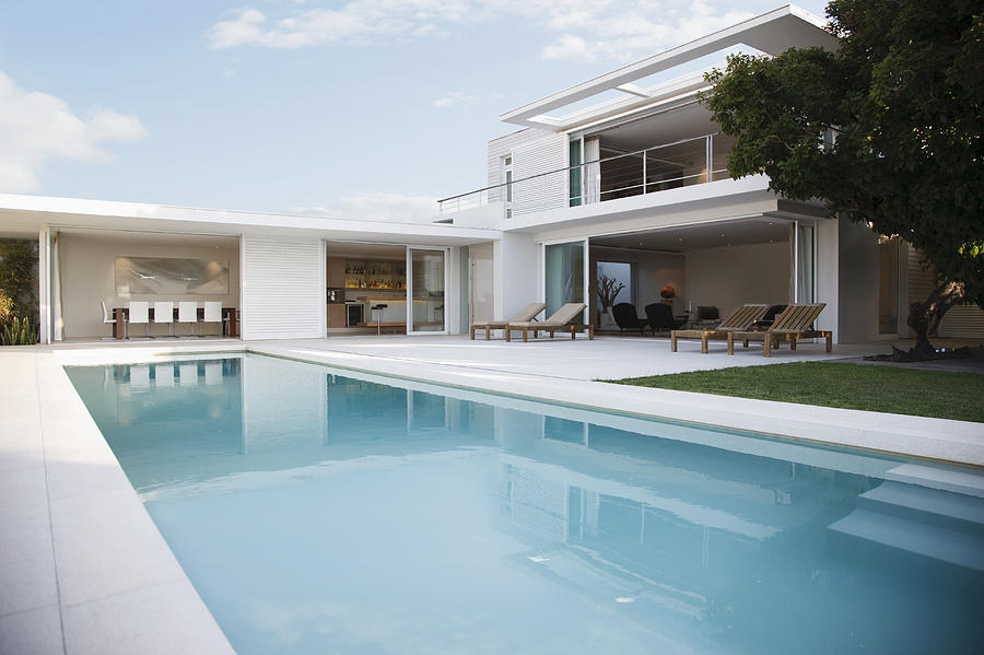 Modern house and swimming pool Photograph by Paul Bradbury