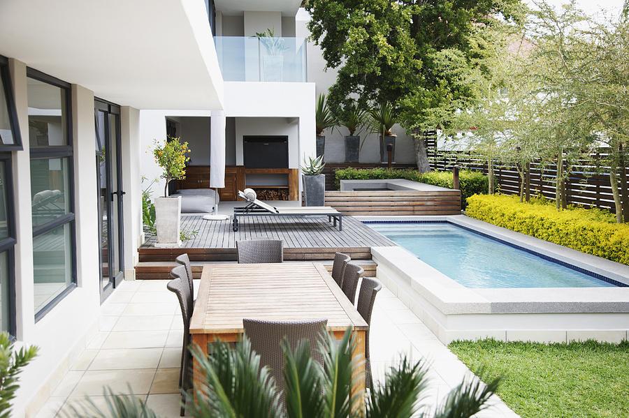 Modern patio next to swimming pool Photograph by Paul Bradbury
