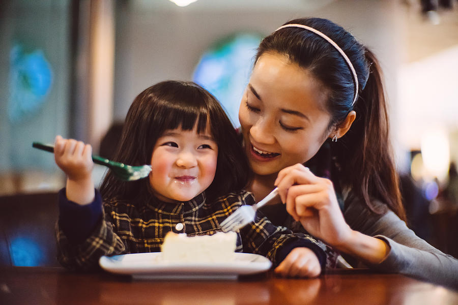 Mom & Toddler Girl Having Cake Joyfully In Cafe Photograph by images by Tang Ming Tung