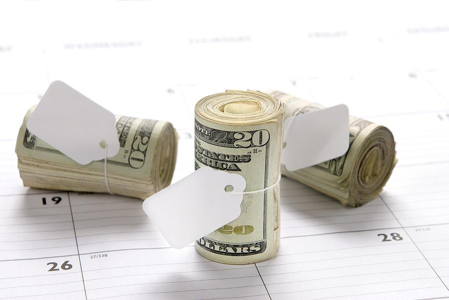 Money Photograph - Money Rolls On Calendar by Joe Belanger