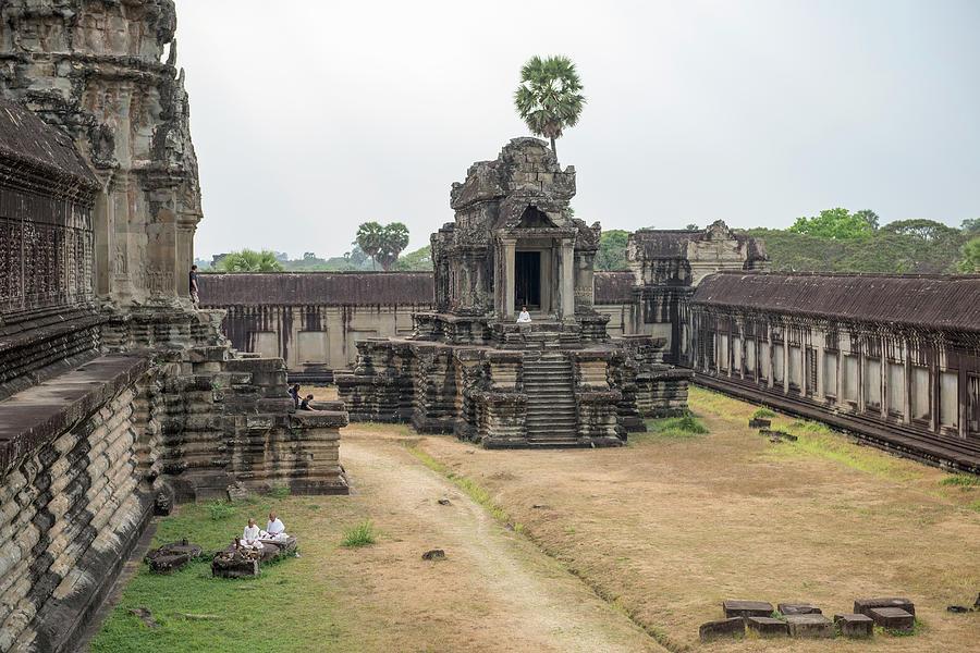 Monks Praying, Angkor Wat, Cambodia Photograph by John Harper