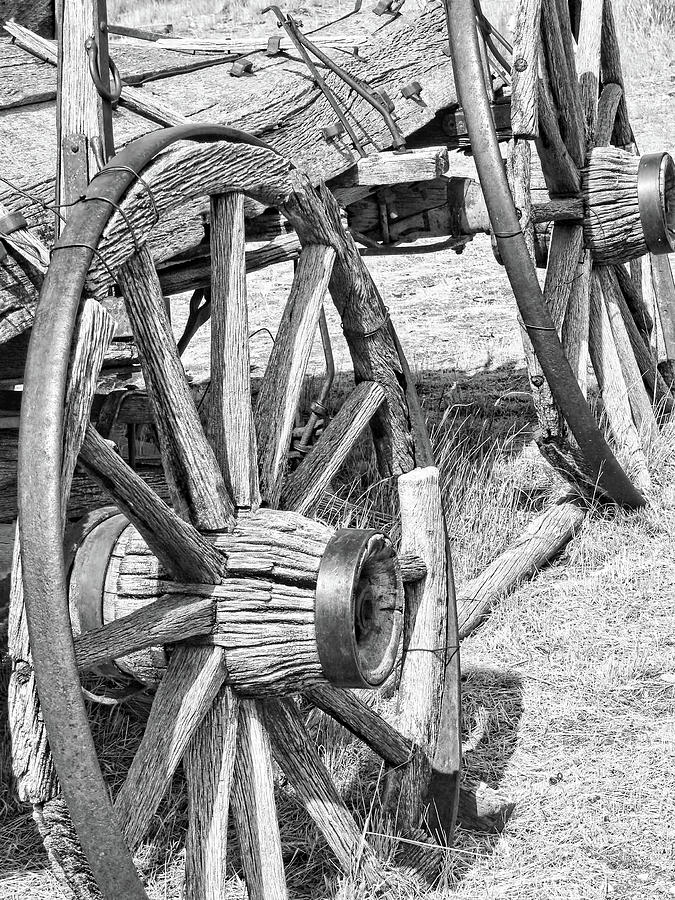 Wheel Photograph - Montana Old Wagon Wheels Monochrome by Jennie Marie Schell