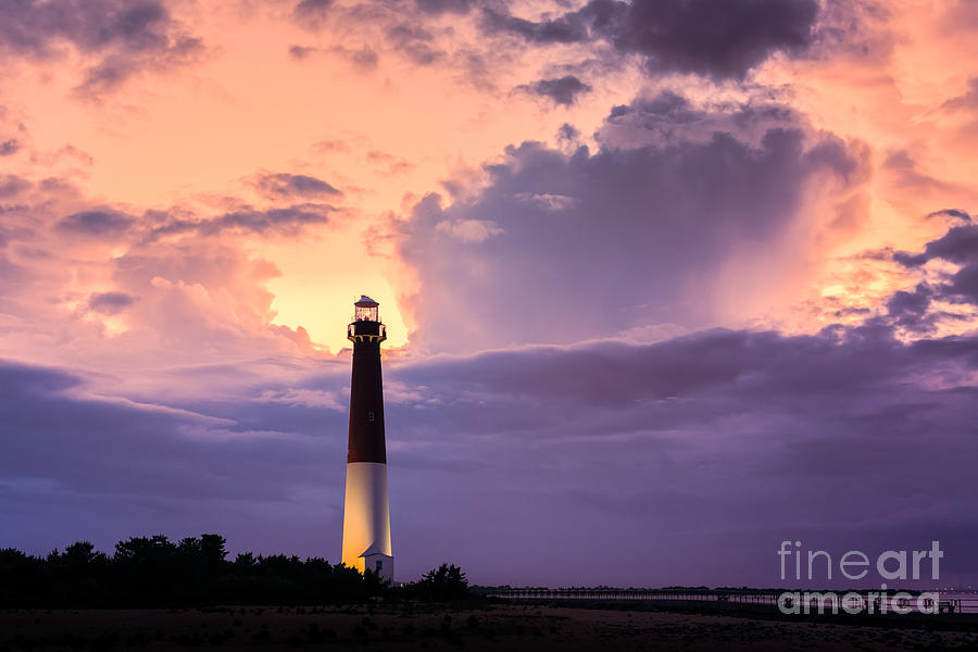 Cloudy Photograph - Moody Sunset At Barnegat Lighthouse by Michael Ver Sprill